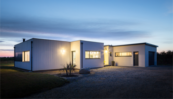 Maison ossature bois plain-pied avec patio intérieur / Trecobois