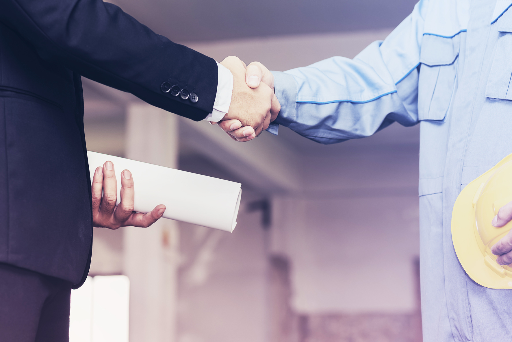 Architect engineer shaking hands with businessman on site,  Teamwork cooperation success collaboration concept